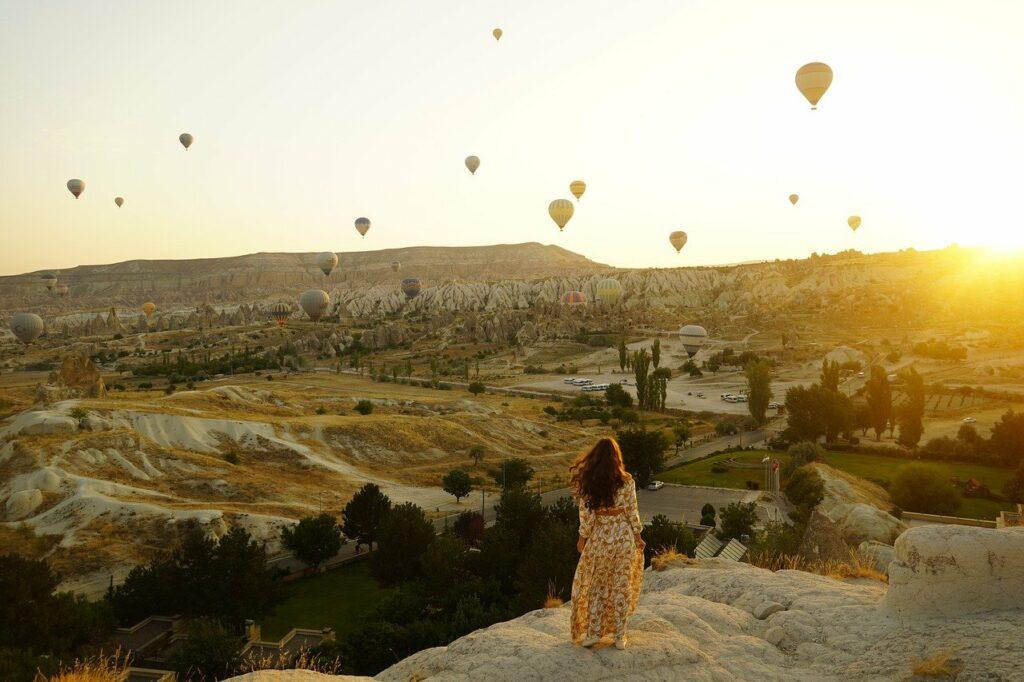 hot air balloons, valley, girl